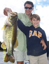 Father and son showing off their lunker bass
