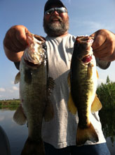Angler sowing his catch from a day with Bass Challenger Guide Service