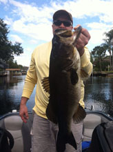 Client with his fish caught on the St. Johns River system with Bass Challenger Guide service