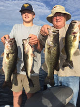 John R and John Sr showing off their catch while fishing with Eddie Bussard of Bass Challenger Guide Service