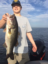 John Sr showing off his catch while fishing with Eddie Bussard of Bass Challenger Guide Service