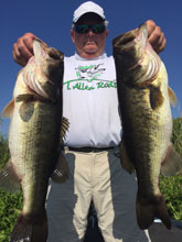 Bill S showing off his catch while fishing with Eddie Bussard of Bass Challenger Guide Service